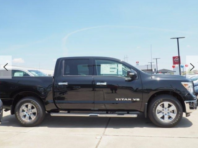 2019 TITAN BLACK CREW CAB SIDE VIEW